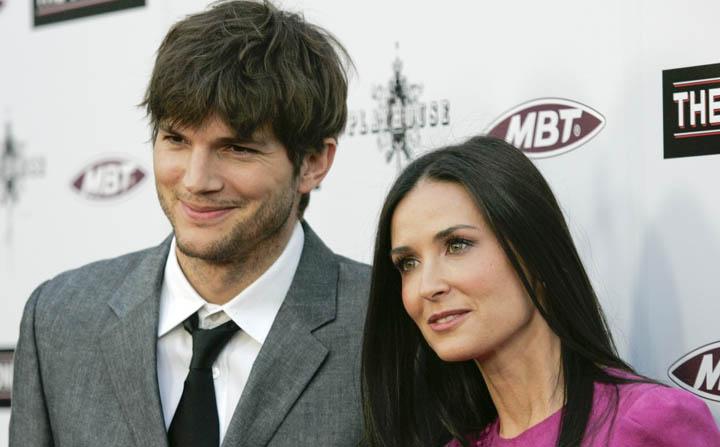 Demi Moore and Ashton Kutcher pose for photographers.