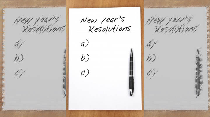 New Year's Resolutions written across the top of a piece of paper with a pen.