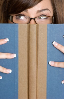 Beautiful girl with her nose in a book