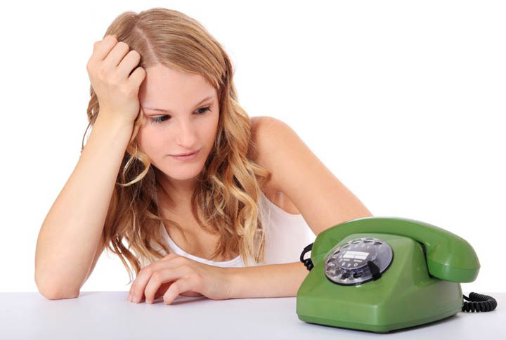 Attractive young woman awaits a phone call. wondering why he hasn't called.