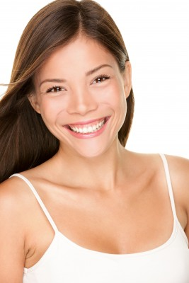 Smiling Woman with Twinkling Eyes that is living her passion
