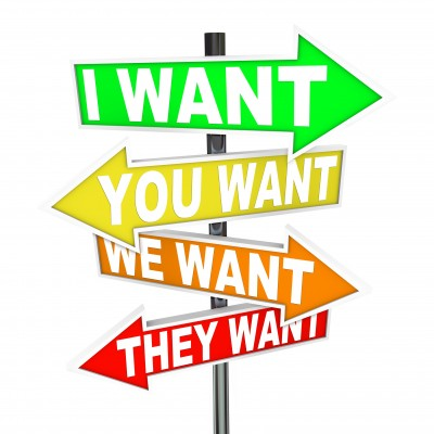 "It's time to be selfish - Road sign pointing in different directions to ""I want"", ""You want"" ""We want"", and ""They want""."