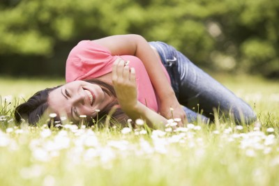 It's not about him, it's about you. A beautiful woman is lying on the grass.