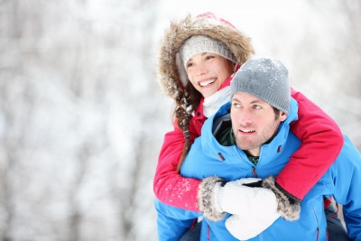 Why would you be attracted to someone who doesn't treat you well if you were confident in who you are and what you have to offer someone?  A happy couple is having fun in a winter scene.