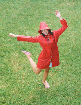 There was always someone I knew who had that confidence about them and their particular relationship, just confidently being in it. A beautiful confident woman is showing her confidence by dancing in a grass field in the rain.