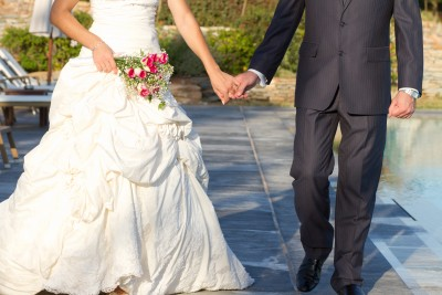 It turns out all of these superficial things don't matter one bit as far as love is concerned. A bride and groom walk hand-in-hand after their wedding.