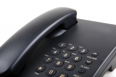 The reality is that you don't know him well enough to know if you even want him to call in the first place! What if he's another player (the fact that he hasn't called yet indicates that he probably is)? Closeup of black telephone.