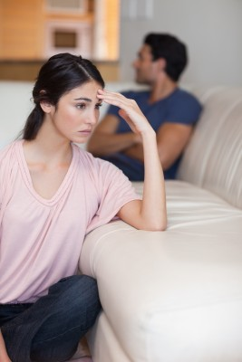 We all want to know the secret to just letting go and not going back. But the reality is that there is no secret. A beautiful woman sits on the floor leaning on the couch with her boyfriend several feet away, in the middle of letting go.