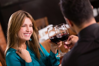 You're meeting guys, dating them for a while, but the end result is always the same – your left alone and brokenhearted. A beautiful woman is on a romantic date with a man in a restaurant.