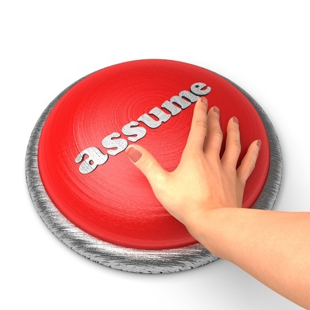 "A woman's hand is on a big red button with the word ""Assume"" on it, ready to push it, indicating that she is once again making assumptions that might ruin her love life."