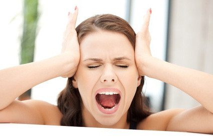 A beautiful woman is holding her head and screaming because of her boyfriends actions - he's distant and says he can't talk about it.