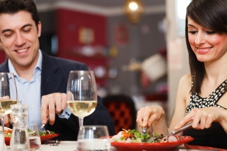 A man and a woman are having what seems to be a romantic formal dinner date but he's sending mixed signals because he says he just wants to be friends.