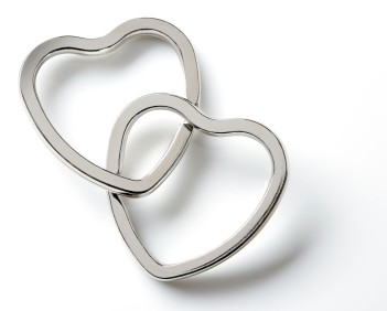 Two silver hearts are forever linked signifying a committed relationship.