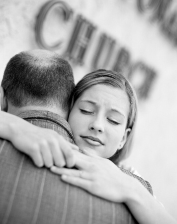 A beautiful woman hugs her father as she thinks about how her father daughter relationship affects her love life.