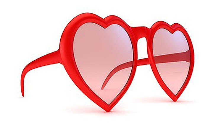 A pair of heart-shaped rose-colored sunglasses indicating falling in love too fast.