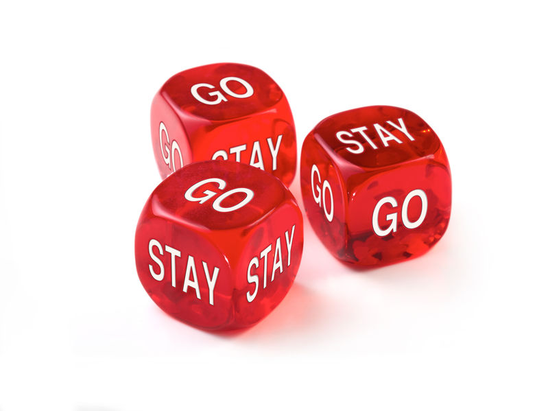 Dice depicting the question of should I stay or should I go?