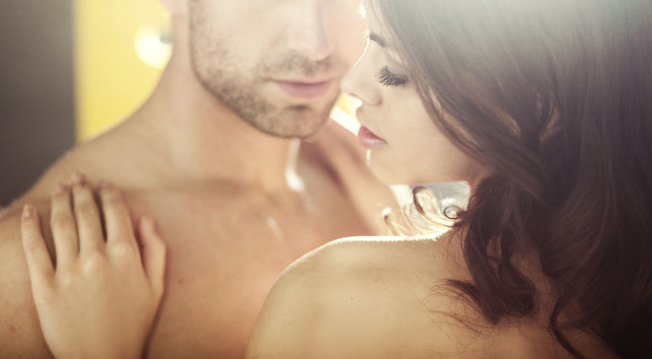 A beautiful woman and man are  becoming intimate.
