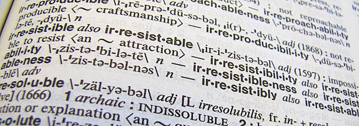 Photos of dictionary showing definition of the word irresistible.