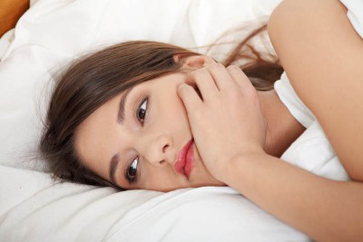 Woman lying in bed upset, wondering if she chased him away