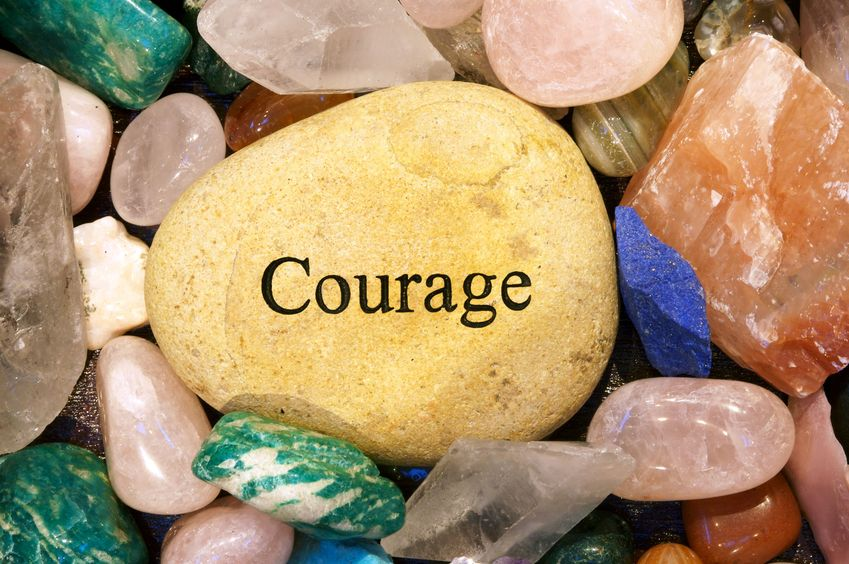 Beautiful rocks with the word courage written on one.