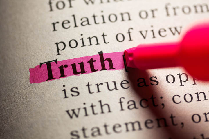 The word truth in a dictionary being highlighted with a red highlighter.