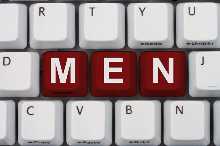 A gray computer keyboard with the word men in red letters