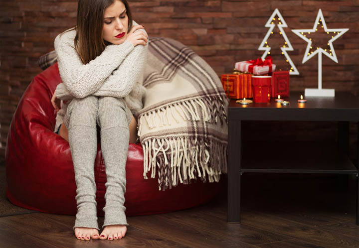 Beautiful sad woman having difficulties with dating during the holidays.