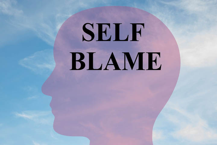 Self Blame written on silhouette of a person's head.
