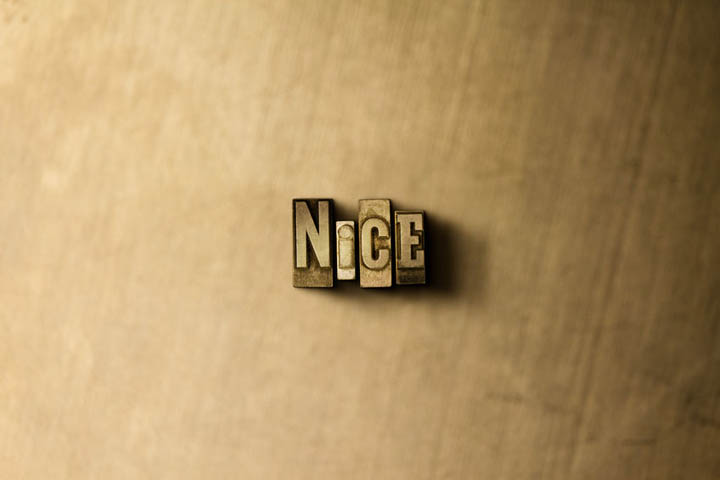 The word nice carved in wood.